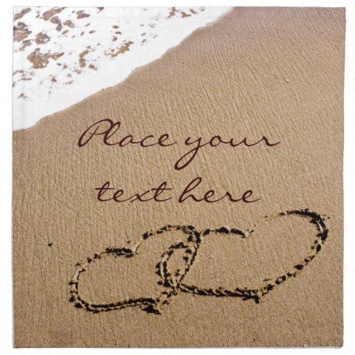 Dos corazones en la arena servilletas