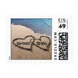 Dos corazones en sellos de la playa del amor del b