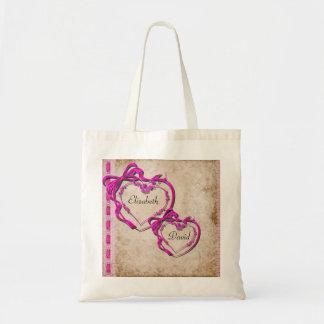 Dos corazones junto bolsas
