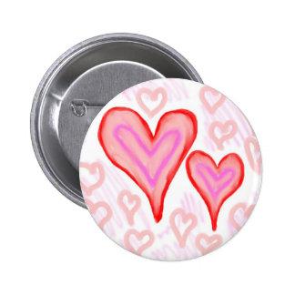 Dos corazones púrpuras rosados rojos rodeados por  pin