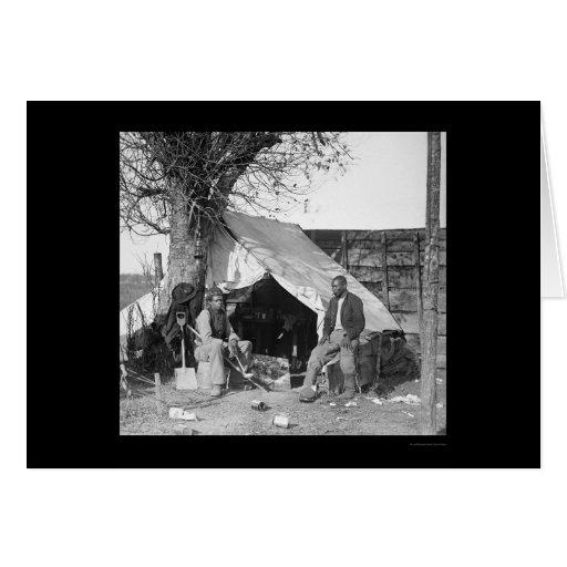 Dos esclavos escapados que se sientan en una tarjeta de felicitación