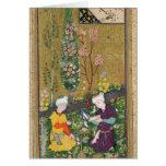 Dos figuras que leen y que se relajan en una huert tarjeta de felicitación