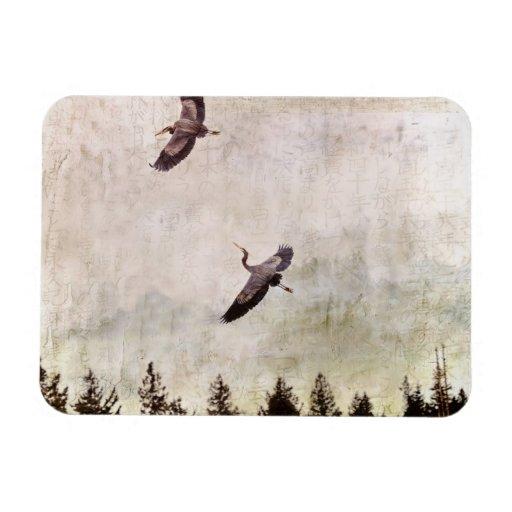 Dos garzas que vuelan la foto imán rectangular