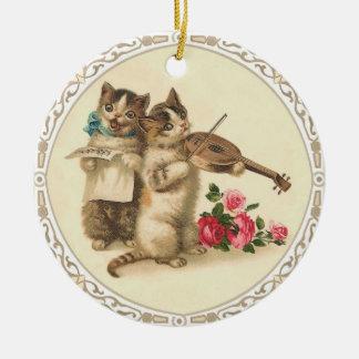 Dos gatitos musicales cantan y tocan el violín adorno de navidad