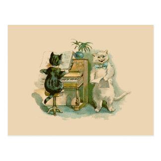 Dos gatos en el piano postal