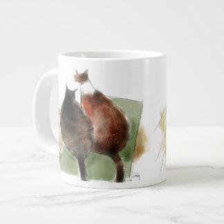 Dos gatos en la manta verde taza grande