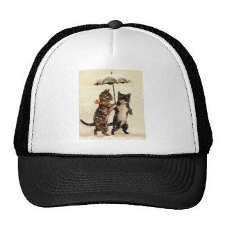 Dos gatos un paraguas gorros bordados