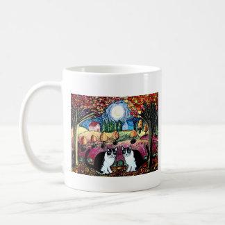 Dos gatos y la luna tazas de café
