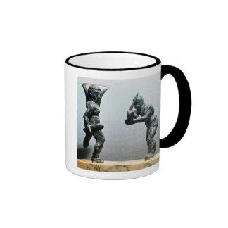 Dos gladiadores en combate tazas de café