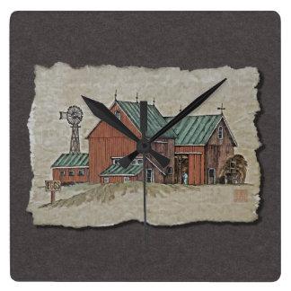 Dos graneros y carros del heno reloj cuadrado
