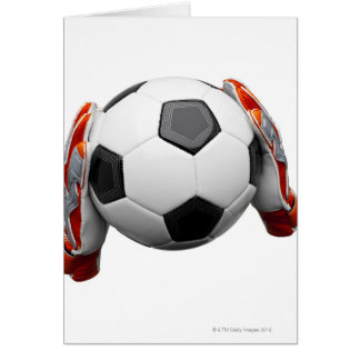 Dos guantes de los encargados de la meta que lleva tarjeta