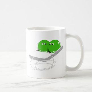 Dos guisantes en una vaina (añada su texto) taza de café