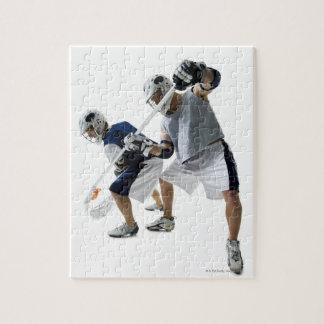 Dos hombres jovenes que juegan a lacrosse puzzle