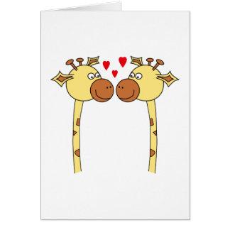 Dos jirafas con los corazones rojos del amor. Dibu Tarjeta