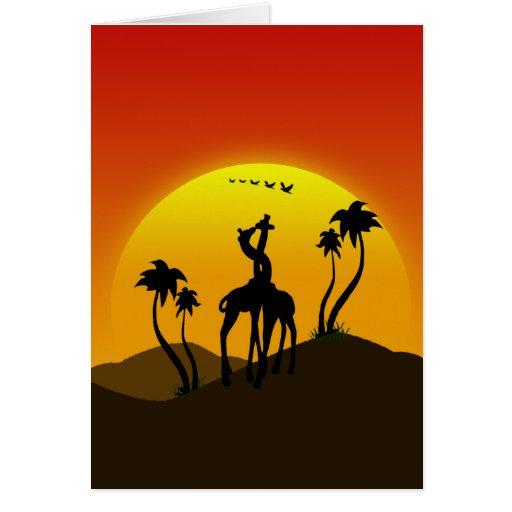 Dos jirafas en amor en la puesta del sol en un día tarjeta