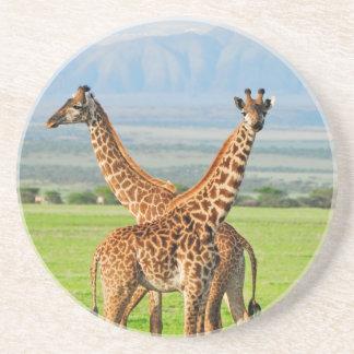 Dos jirafas posavasos diseño