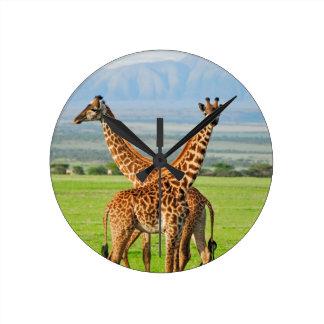 Dos jirafas reloj redondo mediano