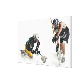 dos jugadores masculinos caucásicos del lacrosse a impresión de lienzo