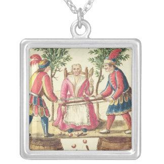 Dos magos venecianos que asierran a una mujer por  colgante cuadrado