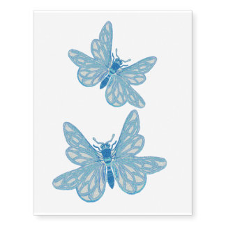 Dos mariposas azules claras tatuajes temporales