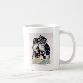 dos mascotas cariñosos adorables del amor lindo de tazas de café