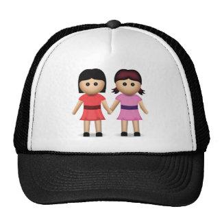 Dos mujeres que llevan a cabo las manos Emoji Gorras