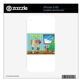Dos niños adorables que intercambian sus regalos calcomanías para el iPhone 4