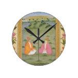 Dos nobles asentados en un paisaje, de la pequeña  relojes de pared