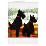Dos perros del escocés en el navidad tarjeton