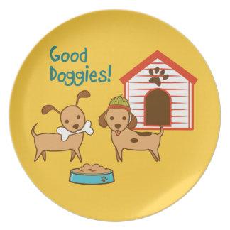 Dos perros lindos con la casa de la comida y de pe plato