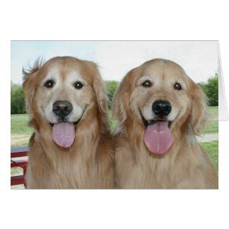 Dos perros perdigueros de oro sonrientes apenas tarjeta de felicitación