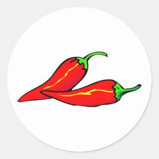 Dos pimientas de chile rojo en lado pegatina redonda