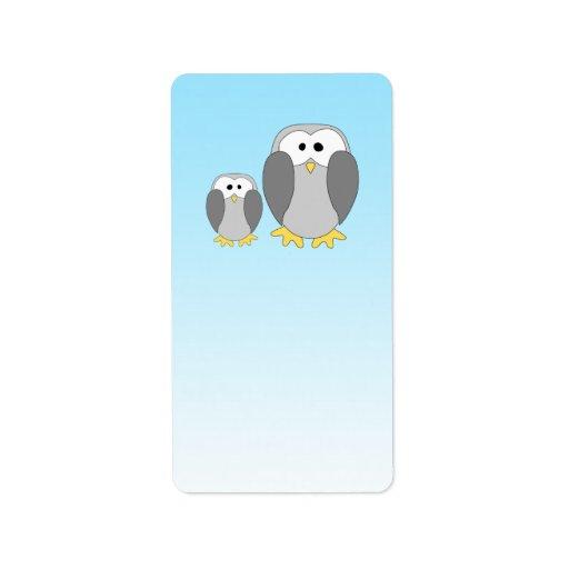 Dos pingüinos lindos. Dibujo animado en azul de ci Etiquetas De Dirección