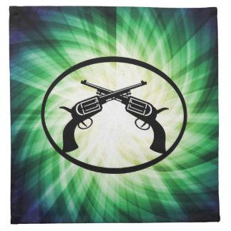 Dos pistolas cruzadas; El brillar intensamente Servilleta