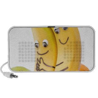 Dos plátanos cariñosos con los ojos y la boca mini altavoz