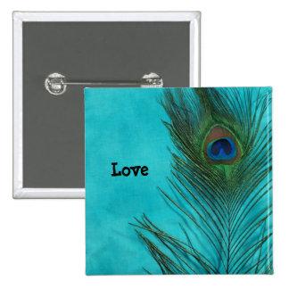 Dos plumas del pavo real de la aguamarina pin cuadrado