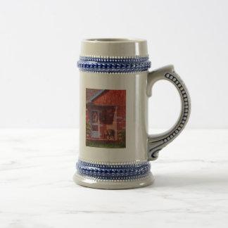 Dos potes de geranios tazas de café