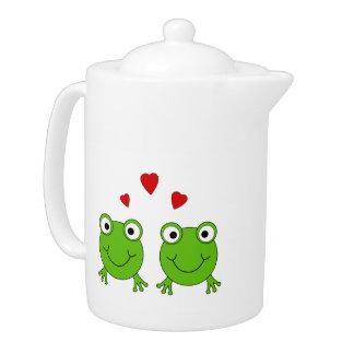Dos ranas verdes con los corazones rojos