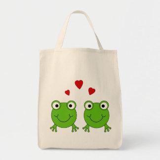 Dos ranas verdes con los corazones rojos bolsa de mano