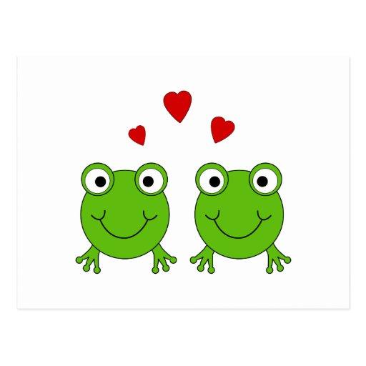 Dos ranas verdes con los corazones rojos postal