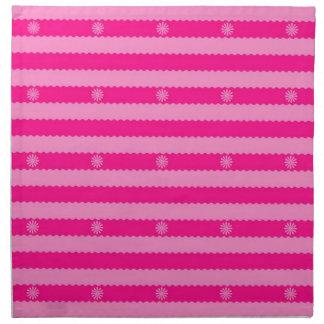Dos rayas y flores brillantes rosadas del tono servilletas imprimidas