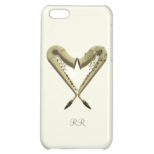 Dos saxofones de oro en corazón forman en el iPhon