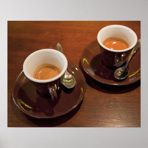 dos tazas de café recientemente elaborado cerveza  poster