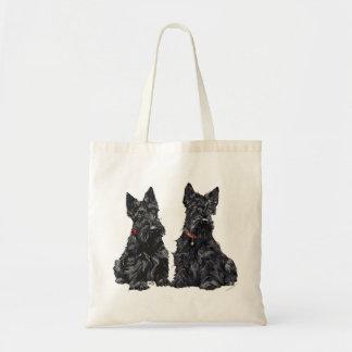 Dos terrieres escoceses negros bolsas