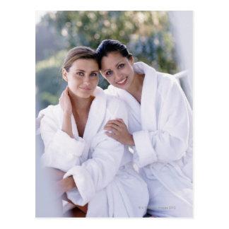 Dos trajes de baño de la mujer que llevan postal
