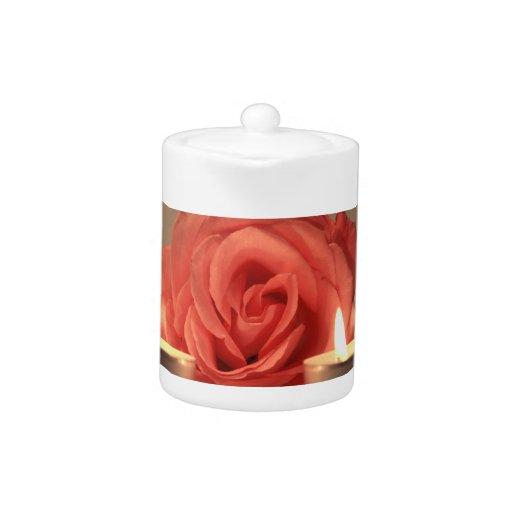 dos velas color de rosa de foto floral del rosa