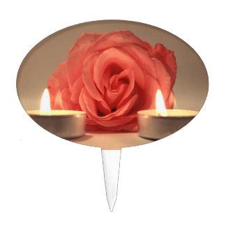 dos velas color de rosa de foto floral del rosa palillos de tarta