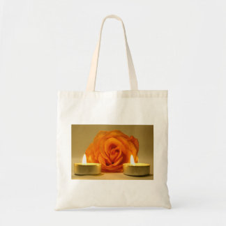 dos velas color de rosa de imagen floral amarillo- bolsas