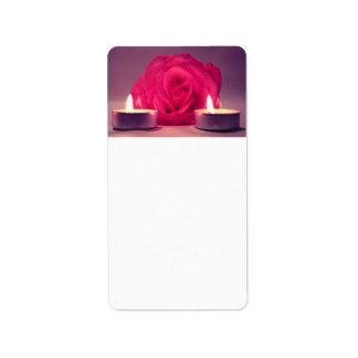 dos velas color de rosa de imagen floral rosada os etiquetas de dirección