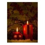 Dos velas de decoración del navidad postales